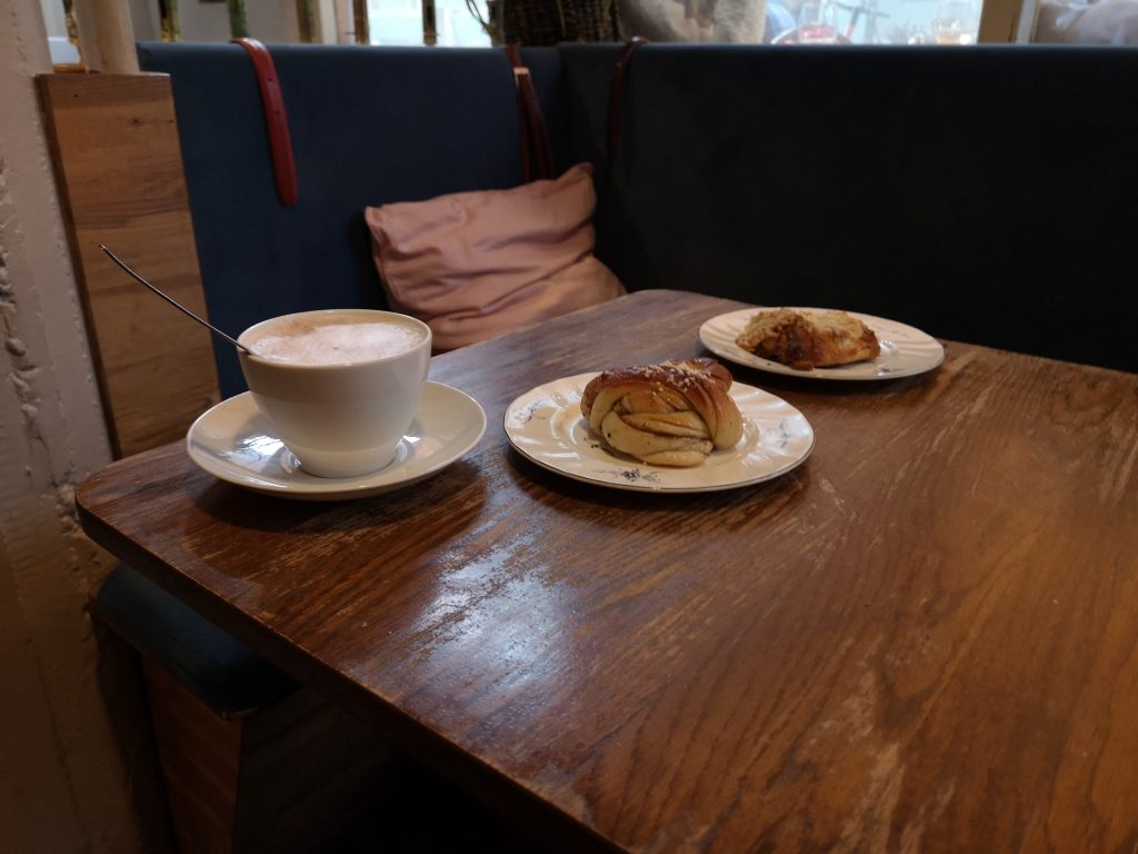 a cinnamon bun, an almond croissant and coffee
