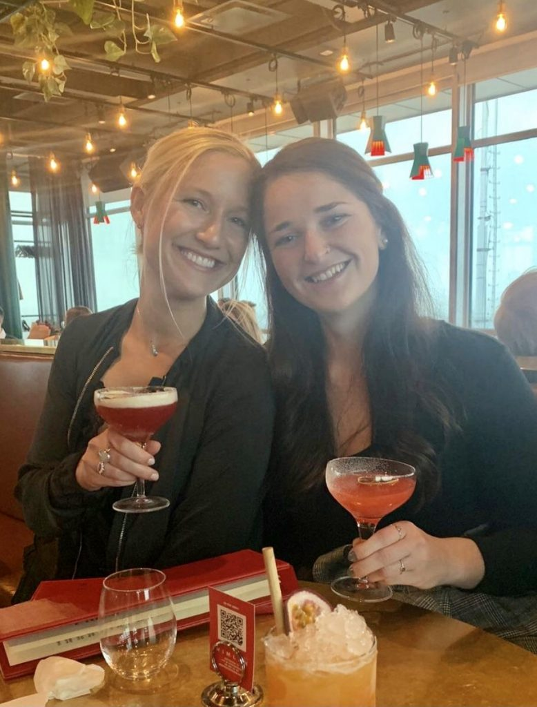 two friends enjoying cocktails