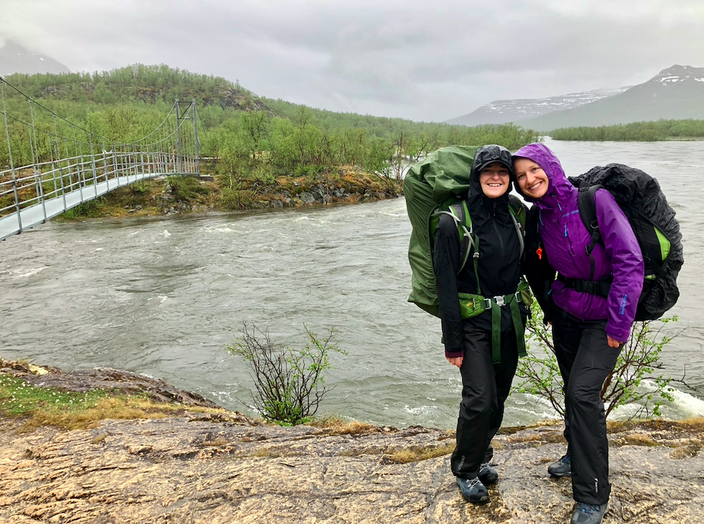 Dressed in rain gear in front of a river