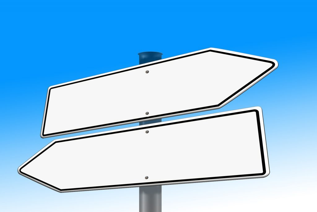 Signs pointing different directions, as if at a crossroads
