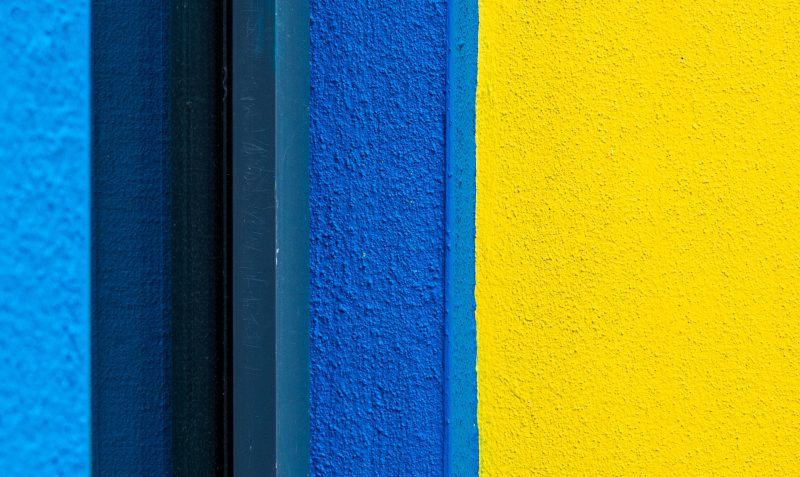 a matte textured wall with shades of blue and yellow
